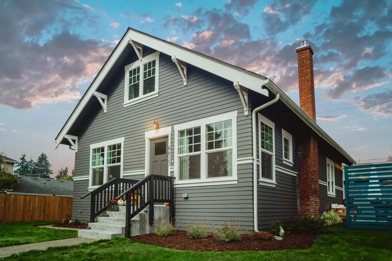 Gray house under colorful sky | REI Software