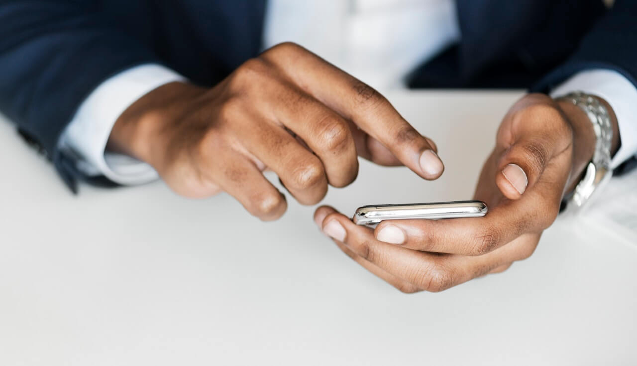 Real estate investor holding smartphone | skip tracing